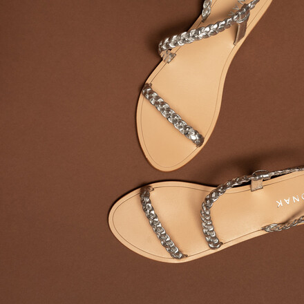 Sandals with braided straps in silver metallic leather