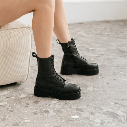 Lace-up boots in black grained leather