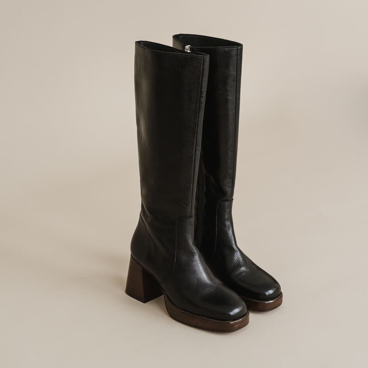Platform boots in aged black leather