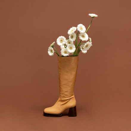 Platform boots in aged camel leather