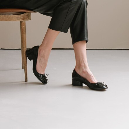 Open back ballet flats in black patent leather
