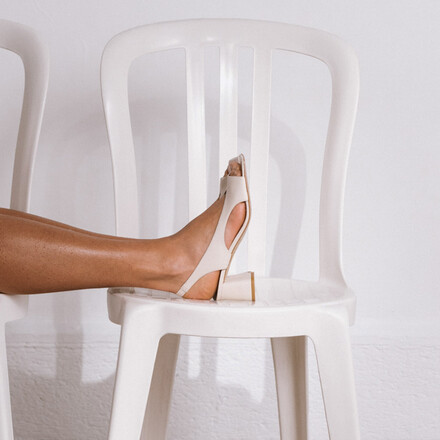 Cut-out heeled sandals in ecru leather