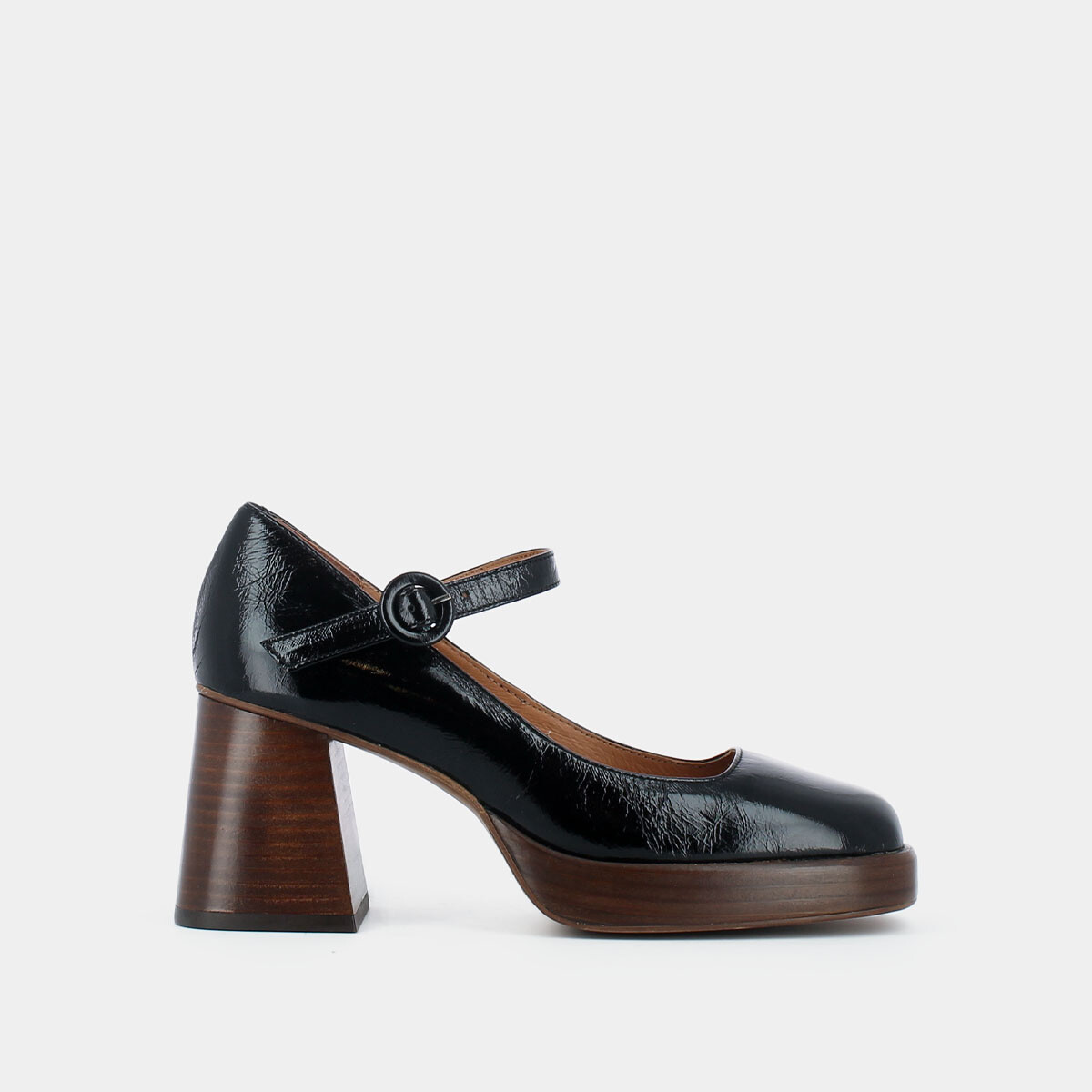 Heeled Mary Janes with platform in black patent leather