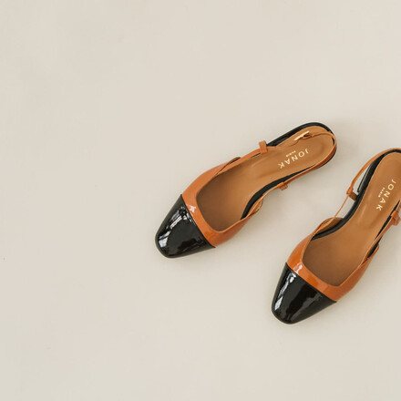 Heeled babies in black and orange patent leather