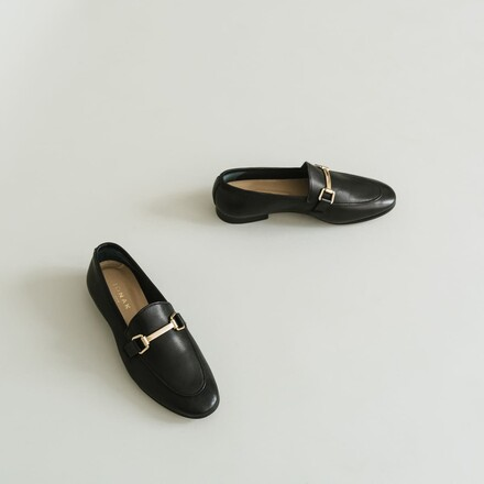 Moccasins with gold embellishment in black leather