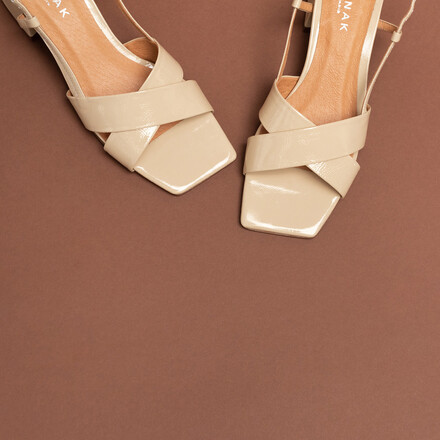 Cross-strap slingback sandals in beige patent leather