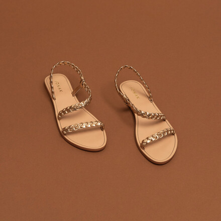 Braided strappy sandals in gold metallic leather