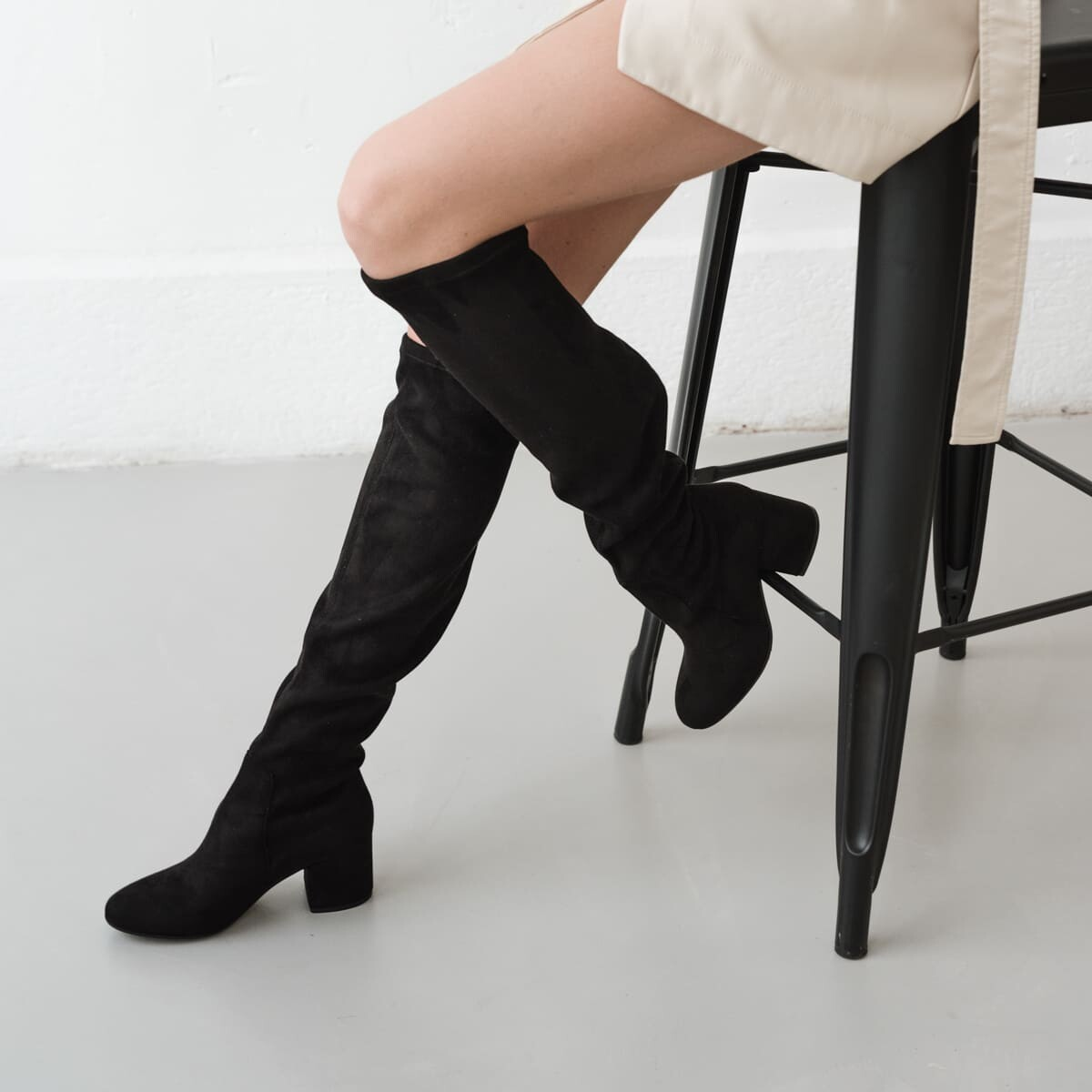 ... Black stretch suede thigh-high boots with low heel noir 5b7411fcf563